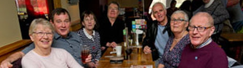 Small party of choir members representing MMVC at the opening of Brewers Fayre in Minehead